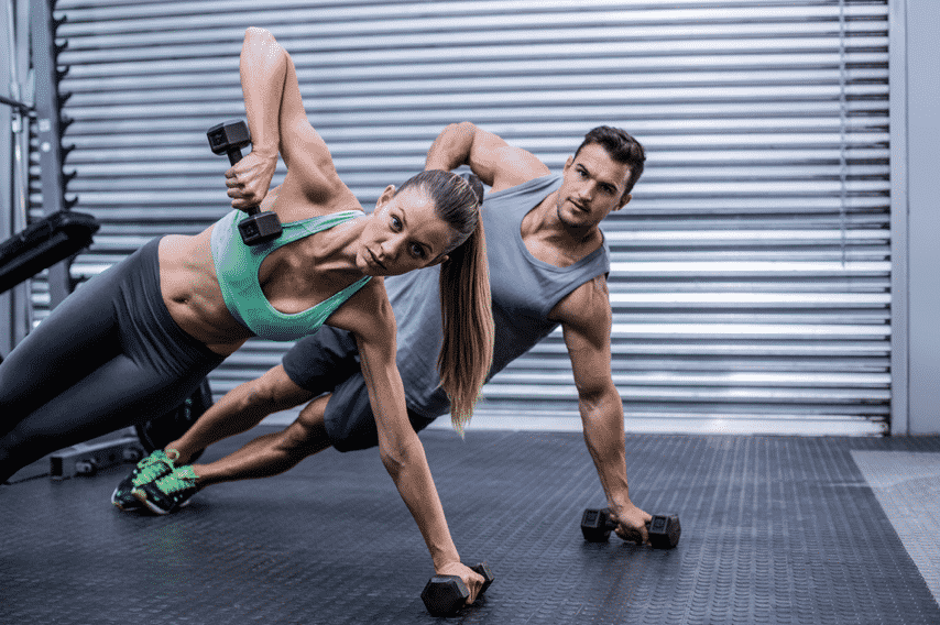 Man And Woman Work Out At A Gym